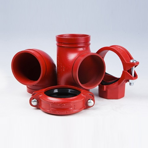 A selection of red ductile iron grooved couplings and pipe fittings